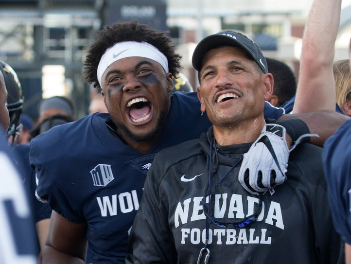 Nevada's Trevion Armstrong, left, celebrates with head