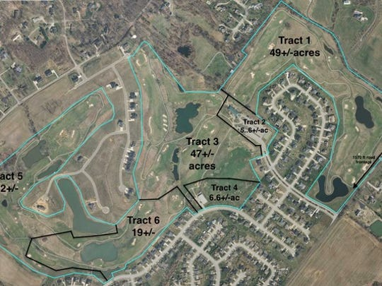 This is an aerial view of the tracts being offered as part of an auction of the former Players Club golf course land next to Wolf Hills subdivision.