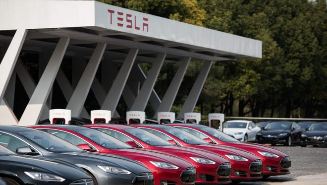This picture taken on  March 17, 2015 shows Tesla Model S vehicles parked outside a car dealership in Shanghai.
