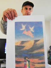 Wirya Ahmad holds a copy of the painting he gave to President Barack Obama. The piece shows a young girl holding a baby doll and cloaked in a Kurdish flag.