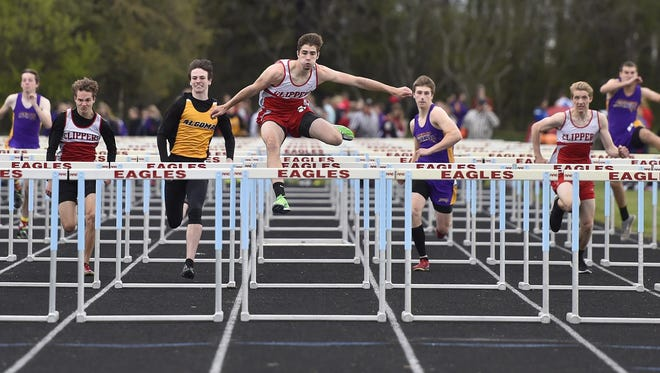 Connor Gajda of Sturgeon Bay on his way to winning the 110-meter hurdles during the Packerland Conference track meet Monday at Southern Door. Gajda also won the long jump and triple jump to help lead the Clippers to the boys team championship.