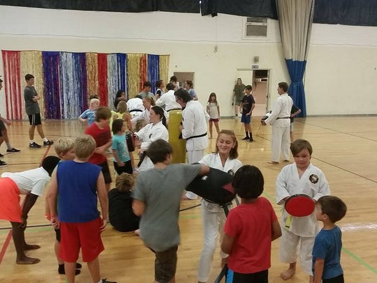 Students practice moves and strikes at the seminar.