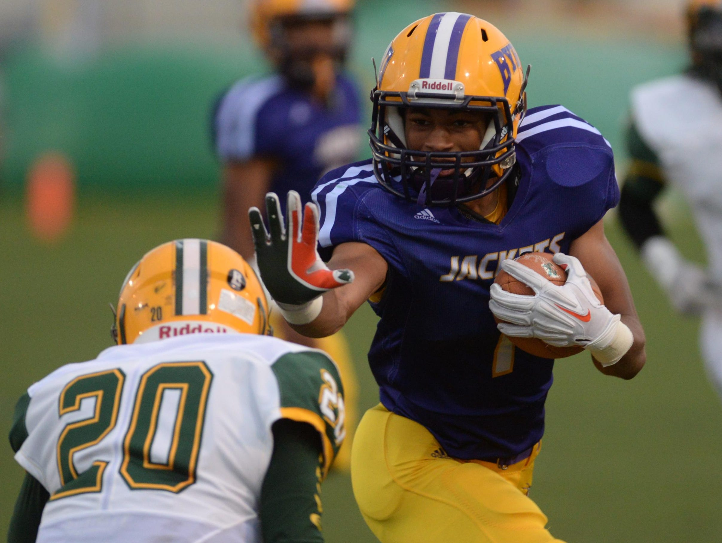 Byrd's Joey Jernigan reaches to stiff arm Captain Shreve's Tramel Roberson during their matchup Thursday night.
