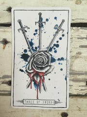 Three of Swords.
