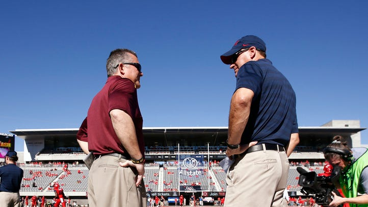 Arizona State's Todd Graham talks to Arizona's Rich