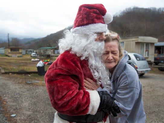 Juanita Johnson gave Mike Howard a heartfelt hug while