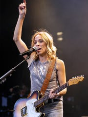 Sheryl Crow performs at Summerfest's American Family Insurance Amphitheater in 2017, as part of Willie Nelson's Outlaw Music Festival. She's on the bill for Chris Stapleton's All-American Road Show tour stopping at Summerfest on June 30, 2020.