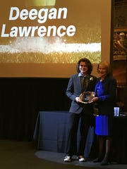 Deegan Lawrence was awarded the Kentucky Boy's Scholastic Achievement award at the United States Tennis Association of Kentucky's annual awards and honors dinner and reception on January 26 at the Louisville Palace.