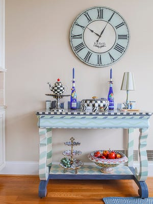 The newly painted furniture let them keep the pieces they loved while giving their space a more relaxed feel.