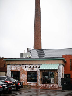 Fiamma's location in the Neighborhood of the Arts has an industrial chic feel.