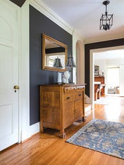 Inside the entryway, the warmth of a well-designed colonial is apparent.