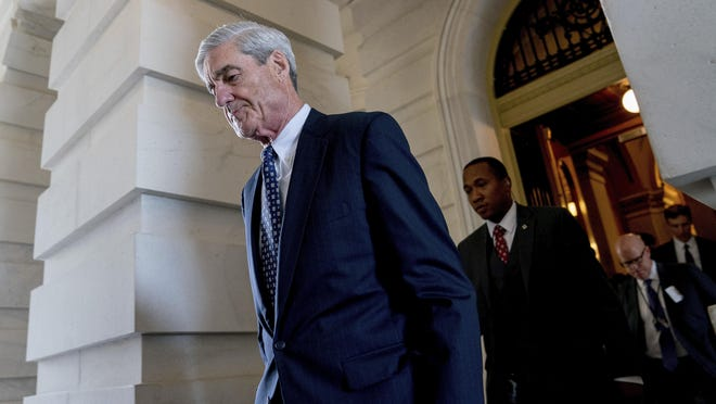 In this June 21, 2017, file photo, former FBI Director Robert Mueller, the special counsel probing Russian interference in the 2016 election, departs Capitol Hill. President Donald Trump is questioning the impartiality of Mueller's investigation and says the probe is groundless, while raising doubts about whether a fired top FBI official kept personal memos outlining his interactions with Trump.