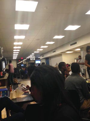 Hundreds of students staged a sit-in at Jackson State University's dining hall Wednesday to show support for a fellow student they said was treated roughly by campus police.