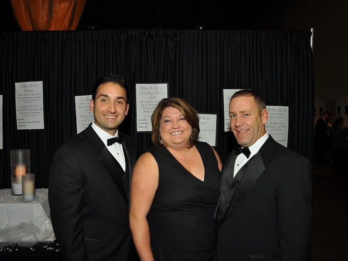The JDRF Hope for a Cure Gala was held Nov. 2, 2013 at the Rochester Riverside Convention Center. The organization expects to make $240,000 to support type 1 diabetes research from the event. Event chairs were, from left, Michael Cimineri of Farmington, Sara Canzano of Victor an Andrew Wambach of Victor.