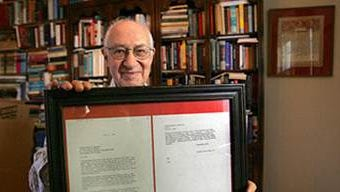 Rabbi Israel Dresner holding a letter Dr. Martin Luther King wrote to him from jail in 1964.