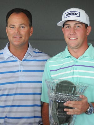 Nick Dilio, right, poses with his caddie and instructor, Tim Panzanaro, left, after winning the 2016 Dutchess County Amateur at The Links at Union Vale Sunday.