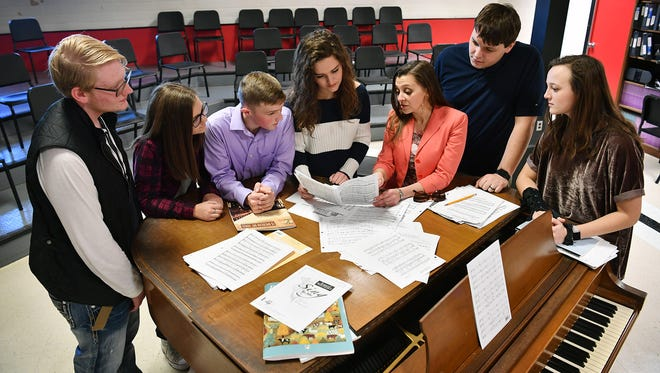 Members of the All-State Choir look over music with Rider High School assistant choir director Sarah Cook, third from right, and Wichita Falls High School Christ Jarvis, second from right in this Jan. 25, 2018, file photo. The five students had recently attended UIL State Choir competition.