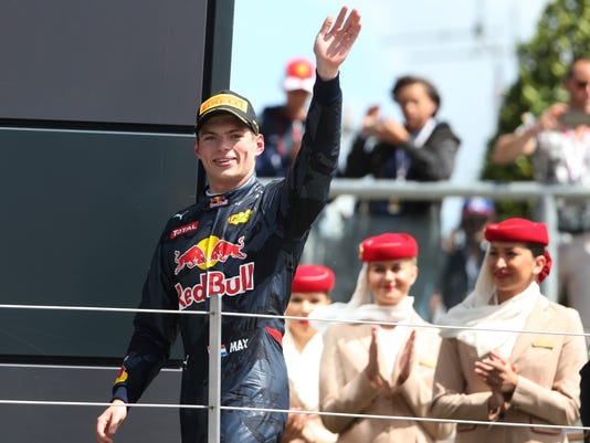 Red Bull driver Max Verstappen, third place, celebrates on the podium after the British Formula One Grand Prix at the Silverstone racetrack, Silverstone, England, Sunday, July 10, 2016. (AP Photo/Luca Bruno)