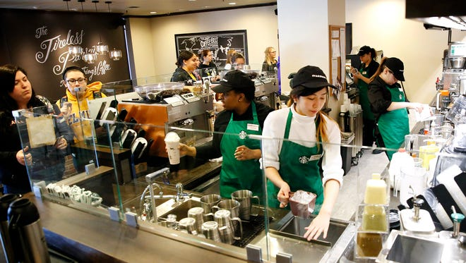 Starbucks baristas work behind the counter at the new Starbucks inside Elmira College's Campus Center.
