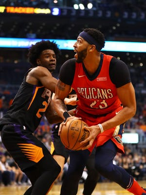 Nov 24, 2017: New Orleans Pelicans forward Anthony Davis (23) against Phoenix Suns forward Josh Jackson in the second quarter at Talking Stick Resort Arena.