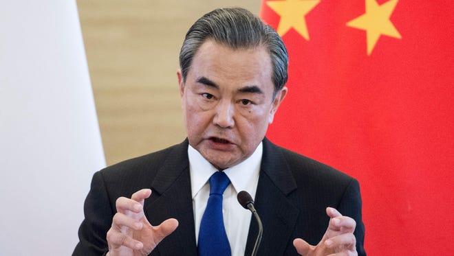 China's Foreign Minister Wang Yi speaks to journalists with his French counterpart Jean-Marc Ayrault during a press conference after their meeting in Beijing on April 14, 2017.