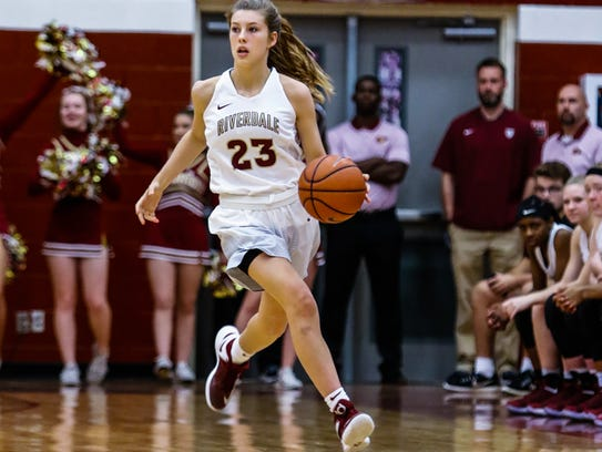 Riverdale junior guard Jalyn Holcomb dribbles upcourt during a recent game. The Lady Warriors are ranked No. 1 in the nation and are off to a 6-0 start.
