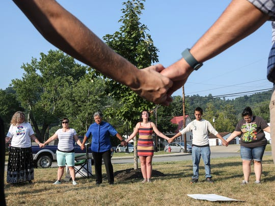 Gay marriage supporters join hands in prayer outside at the Rowan County Clerk's Office in Morehead on Sept. 4, 2015.