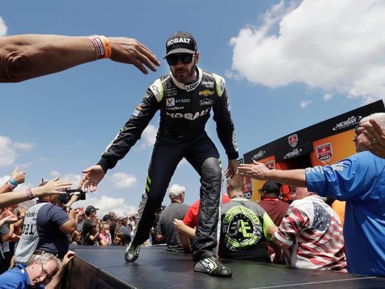 Jimmie Johnson greets fans before a NASCAR Sprint Cup