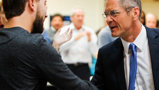 Michigan Democratic Gubernatorial Candidate Mark Schauer, left, shakes hands with members of the UAW Local 6000 on a campaign stop at the Local 6000 headquarters in Lansing, Monday, October 13, 2014.  [Photo October 13, 2014 by MATTHEW DAE SMITH | for the Lansing State Journal]
