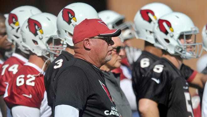 "Bruce Arians, head coach of Arizona Cardinals, runs his team through a morning session of organized team activities, or OTAs, at the Cardinals training facility in Tempe, Ariz. in June. Arians, a native of York County, was named NFL coach of the year during the 2014 season. NFL Network will highlight Arians Friday in a feature documentary ""A Football Life: Bruce Arians""."