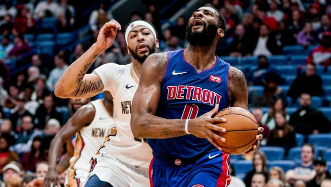 Pistons center Andre Drummond (0) drives past Pelicans forward Anthony Davis (23) during the first quarter on Monday, Jan. 8, 2018, in New Orleans.