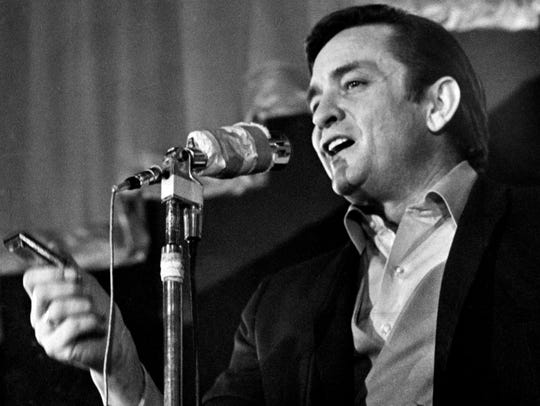 Country music star Johnny Cash performs for the inmates