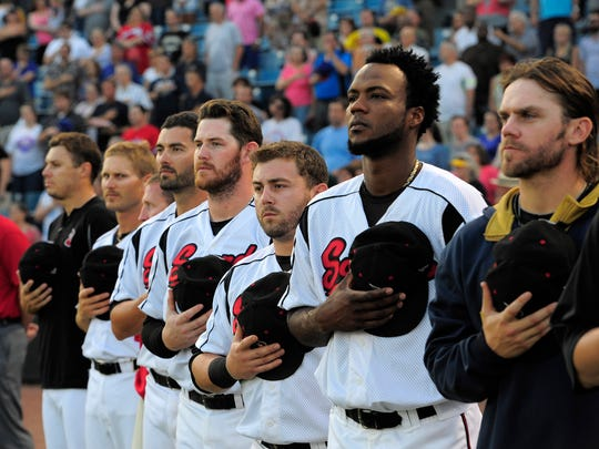 Sounds players listen to the National Anthem sung by the Oak Ridge Boys before the last game at Greer Stadium Wednesday Aug. 27, 2014, in Nashville, Tenn.