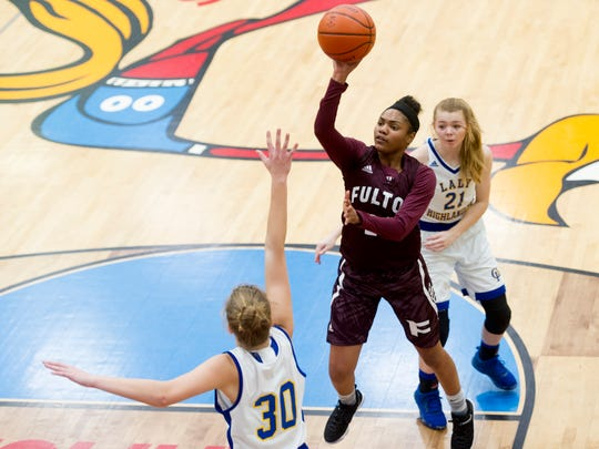 Fulton's Jalayah Manning (24) goes for a layup past Gatlinburg's Ivy Bales (30) during the Region 2-AA finals game between Gatlinburg-Pittman and Fulton at Austin-East High School in Knoxville, Tennessee on Wednesday, March 1, 2017.