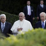 Pope Francis is flanked by Israel's President Shimon Peres, right, and Palestinian President Mahmoud Abbas during an evening of peace prayers in the Vatican gardens, Sunday, June 8, 2014.