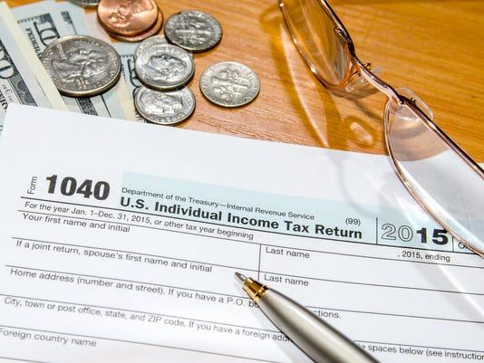 636063567038809801-taxes.jpg