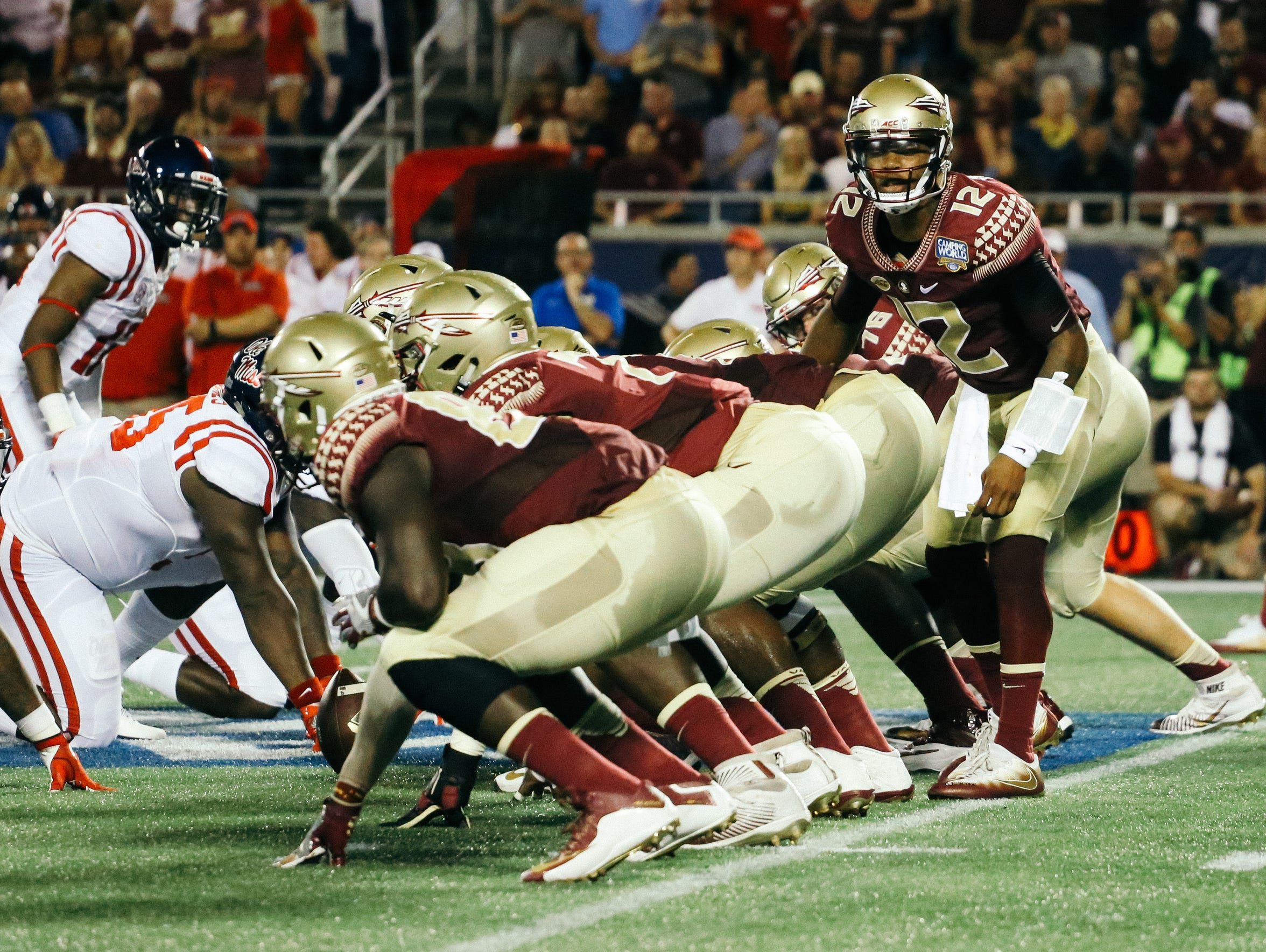 Deondre Francois (12) looks to the sidelines in his