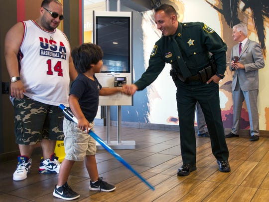 Jacob Cancel, 5, of Fort Myers, greets captain Carmine