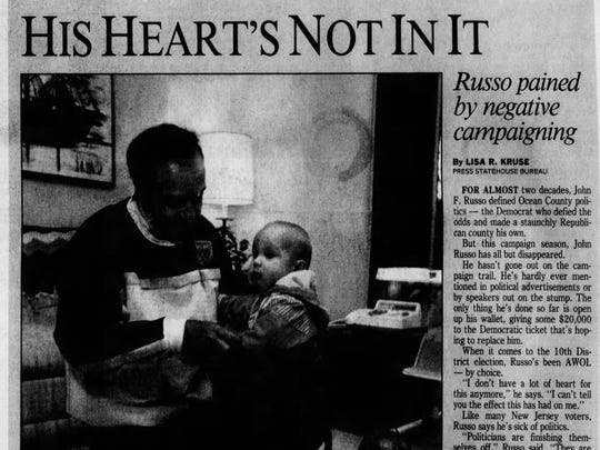 This clipping from the Asbury Park Press, dated Nov. 5, 1991, illustrates Senate President John F. Russo holding his grandson before he stepped down from office.