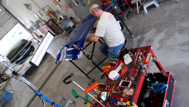 Auto hail repair specialist Trey Pool is among those who set up shop in Las Cruces recently, one of many who have begun repairing hail damage on local vehicles.