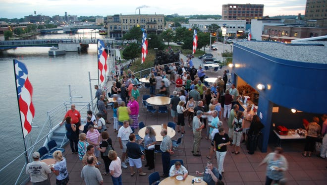 Lincoln High School's 1976 graduating class met last Friday at the Wisconsin Maritime Museum to reconnect and watch the Lakeshore Balloon Glow.