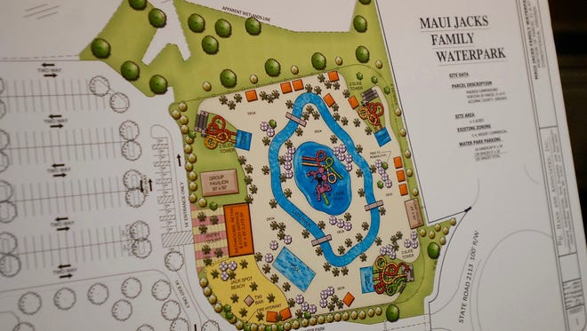 A crowd braved a torrential downpour to attend a joint meeting of the Chincoteague Town Council and Planning Commission on Thursday, Oct. 29 to hear details of a proposed waterpark in Maddox Family Campground.