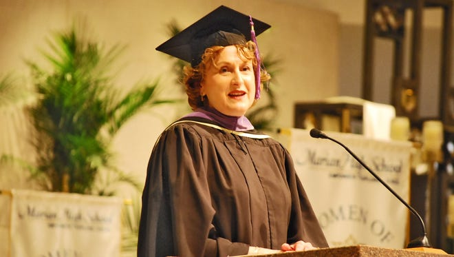 Marian 2017 Distinguished Alumna, Barbara Spreitzer-Berent spoke to the graduates at their commencement ceremony at St. Hugo of the Hills Church.