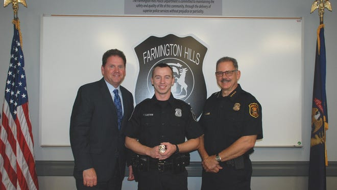 Farmington Hills City Manager Dave Boyer, Officer Timothy Sjostrom, and Police Chief Charles Nebus.