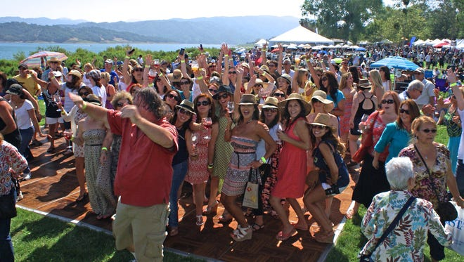 A packed dance floor is part of the revelry at the Ojai Wine Festival. This year's event is June 10, on the shores of Lake Casitas.