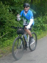 "Rochester Hills resident Doug Carnegie, 66, enjoys a 26-mile Michigander training ride from Rochester to Romeo and back on the Macomb Orchard Trail on June 20, 2015. Carnegie underwent a successful heart transplant operation at the Mayo Clinic in November, 2014 -- and signed up for his second Michigander six months later. Carnegie received a touching anonymous letter, handwritten on notebook paper, from the donor's family. An excerpt: ""He was a (busybody), never could sit still ... you will stay in (our) prayers forever."""