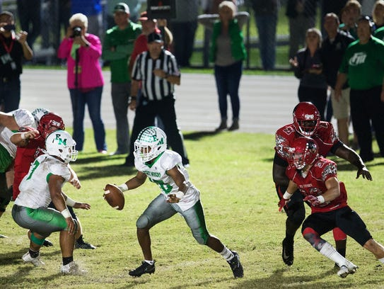 Myers High School's Willie Neal gains a first down