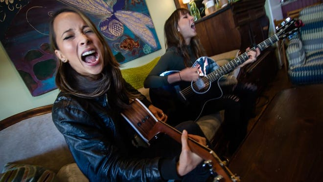 Sarina and Nalani Bolton, a twin sister duo from Flemington, will perform their original songs this summer at the Black Potatoe Festival in Clinton. They are pictured at the Dragonfly Music & Coffee Cafe in Somerville.