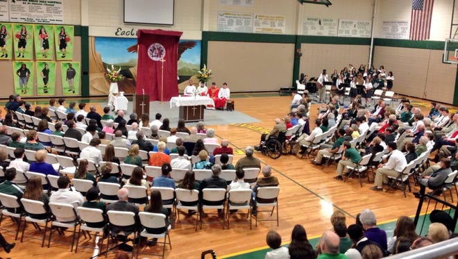 Grandparents join their students Wednesday at Holy Savior Menard Central High School for mass during Catholic Schools Week.