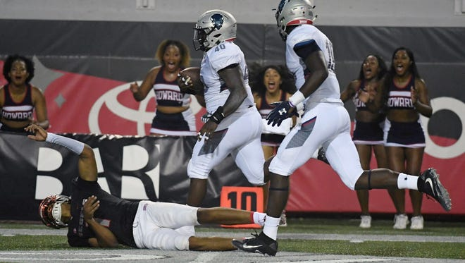Howard linebacker Devin Rollins  gets past UNLV quarterback Armani Rogers to score a 75-yard touchdown off a recovered fumble.